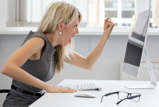 woman-angry-at-mac-computer-shutterstock-510px